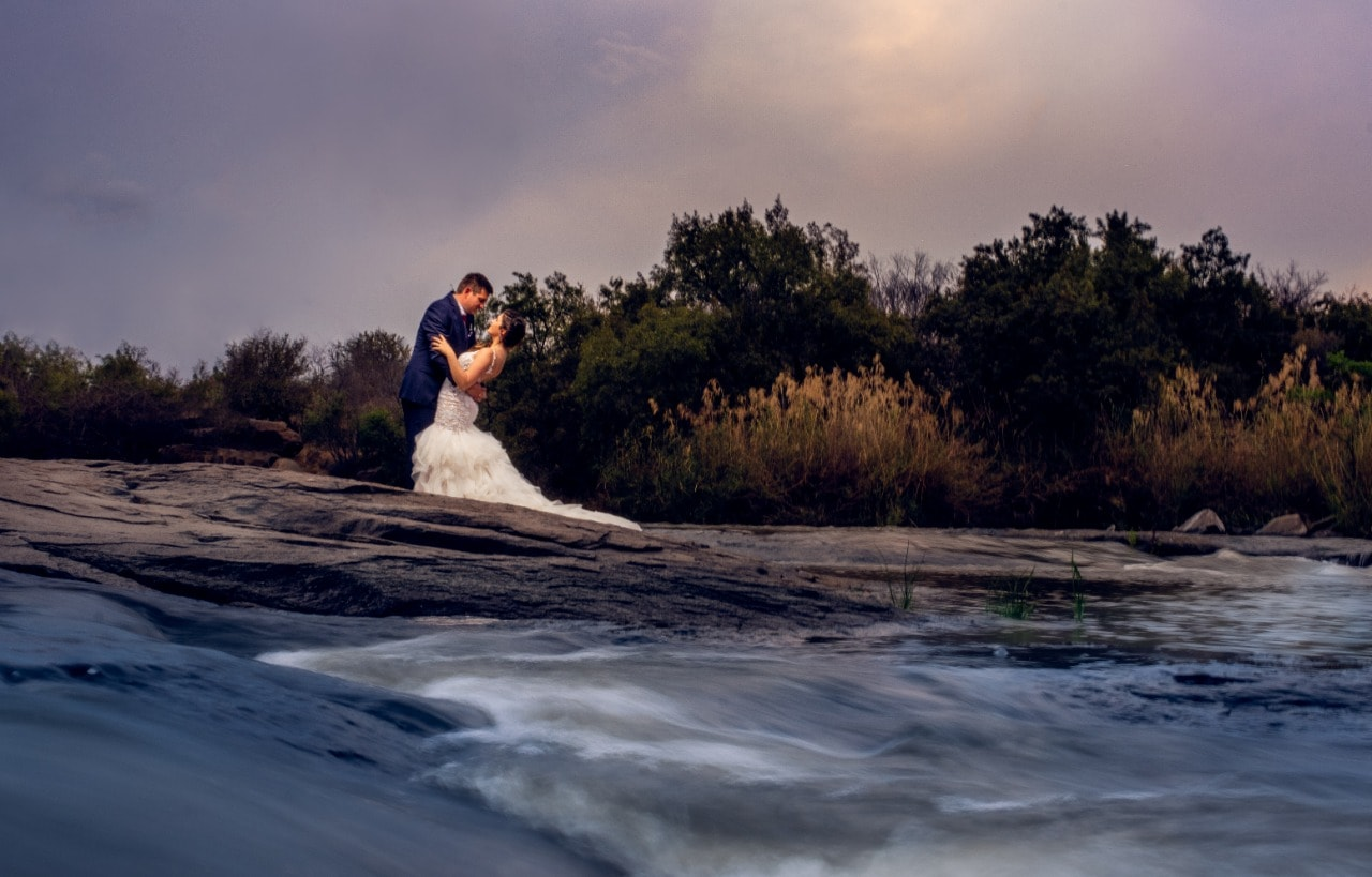 Altydgoed bridal couple at river